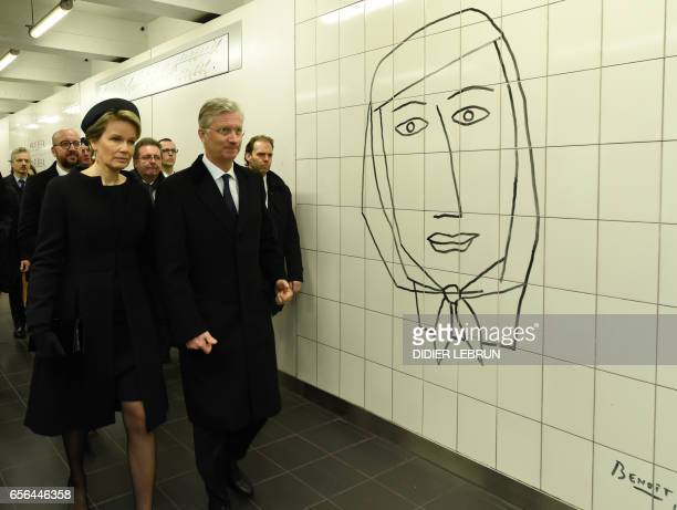 TOPSHOT Queen Mathilde of Belgium and King Philippe of Belgium pass by a Benoit Van Innis artwork as they arrive for a minute of silence at 0911 in...