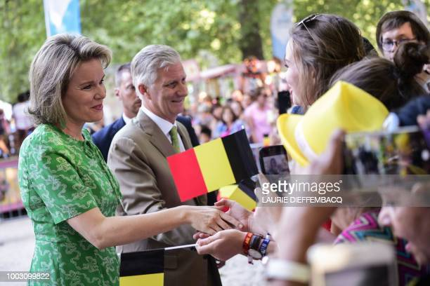 Queen Mathilde of Belgium and King Philippe of Belgium shake hands with residents during a Royal Visit to the 'Fete au parc Feest in the Park'...