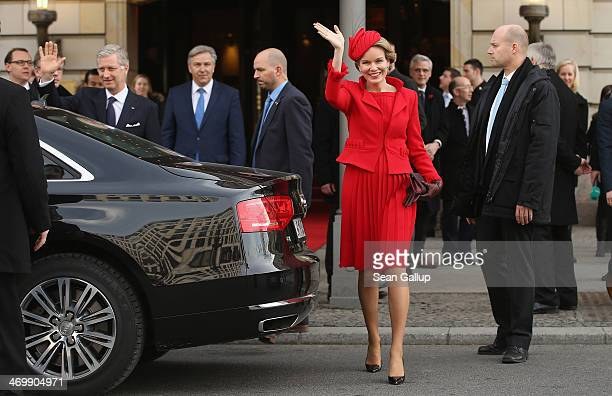 Queen Mathilde of Belgium and King Philippe of Belgium wave to onlookers as they depart the Adlon Hotel as Berlin Mayor Klaus Wowreit looks on on...