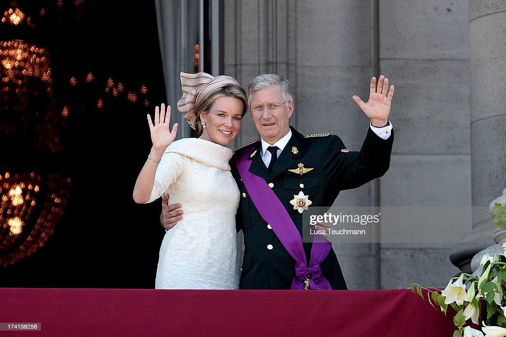 Queen Mathilde of Belgium and King Philippe of Belgium wave to the audience from the balcony of the Royal Palace during the Abdication Of King Albert II Of Belgium, & Inauguration Of King Philippe on July 21, 2013 in Brussels, Belgium.