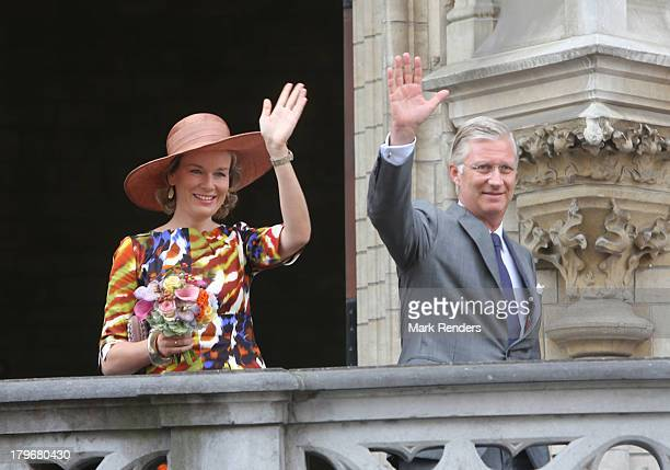 """Queen Mathilde of Belgium and King Philipppe of Belgium make their first visit to the city, known as the """"Joyous Entry"""", on September 6, 2013 in..."""