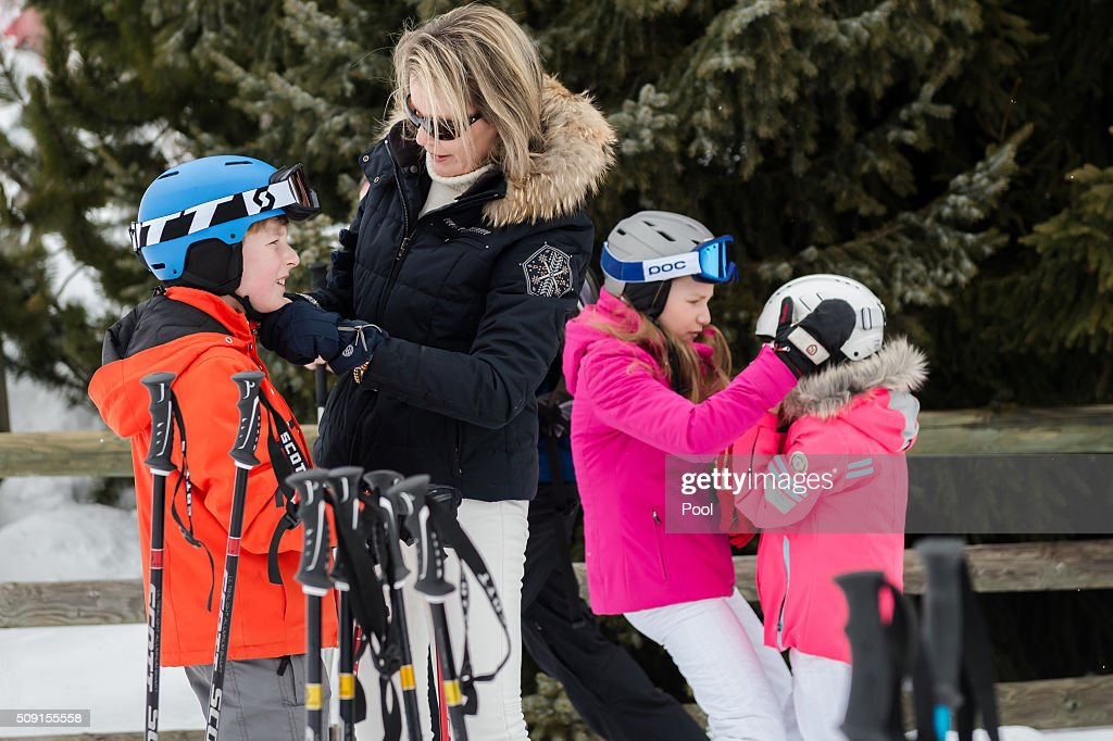 Queen Mathilde of Belgium (2nd R) and Princess Elisabeth, Duchess of Brabant (2nd R) help Prince Emmanuel of Belgium (L) and Princess Eléonore of Belgium (R) with their helmets before going skiing during their family skiing holiday on February 08, 2016 in Verbier, Switzerland.