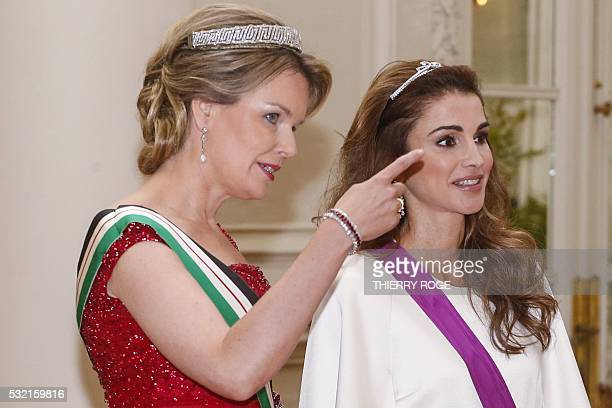 Queen Mathilde of Belgium and Queen Rania of Jordan attend a gala dinner at the Laeken royal Palace in Brussels on May 18 2016 / AFP / BELGA /...