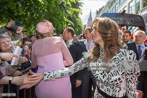 Queen Mathilde of Belgium and Queen Rania of Jordan meet and greet the people as they leave The Chocolate Line shop founded by award winning...
