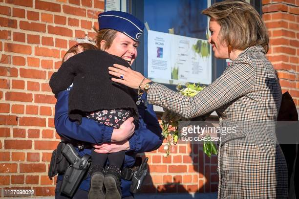 Queen Mathilde of Belgium arrives for a visit of Belgian Royal couple in Antwerp province with a social and artistic workshop called De Loods for...