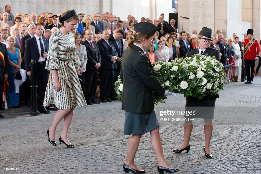 Queen Mathilde of Belgium (L) arrives to lay a floral tribute during the 30,000th 'Last Post' ceremony at the Menenpoort in Ieper, on July 9, 2015.