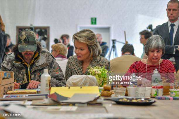Queen Mathilde of Belgium attends a social and artistic workshop organised for psychologically vulnerable people during a visit of the Belgian Royal...
