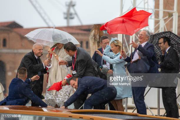 Queen Mathilde of Belgium boards the vaporetto to leave the Biennale of Venice with heavy wind on September 06, 2019 in Venice, Italy.