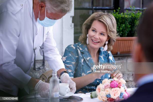 Queen Mathilde of Belgium enjoys a cup of coffee after a visit to the renovated Gruuthusemuseum on June 16, 2020 in Bruges, Belgium. During her visit...