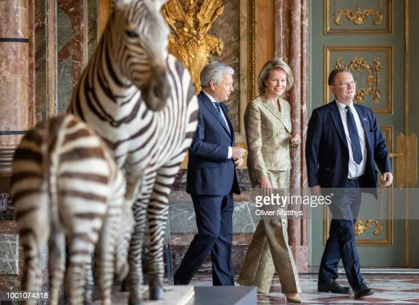 Queen Mathilde of Belgium Foreign Minster Didier Raeynders and the curator walk past stuffed zebra's during the official opening of the Africa Museum...