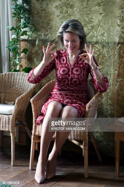 Queen Mathilde of Belgium gestures as she speaks during a visit to WCUDANCE project on March 6 2018 in Wijnegem / AFP PHOTO / BELGA AND Belga /...