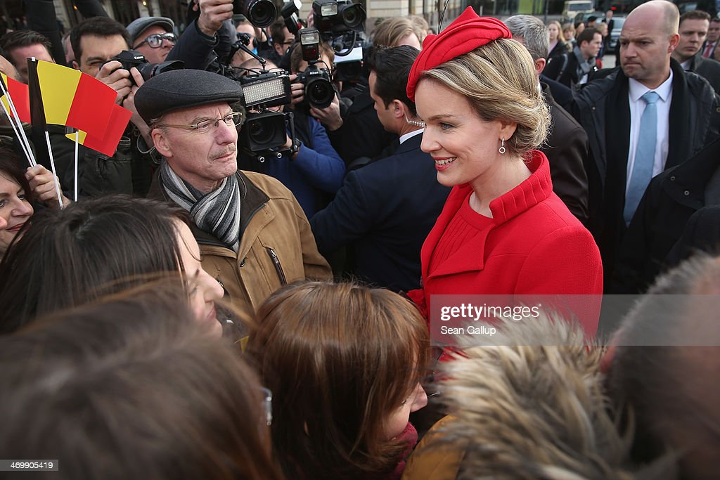 Queen Mathilde of Belgium greets onlookers on Pariser Platz on February 17, 2014 in Berlin, Germany. King Philippe and Queen Mathilde are in Berlin to attend a German-Belgian conference.