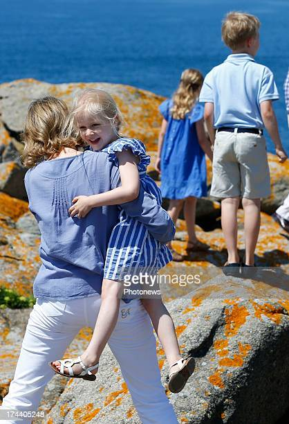 Queen Mathilde of Belgium holding Princess Eleonore of Belgium in her arms during their holiday on l'Ile d'Yeu on July 24 2013 in Yeu France