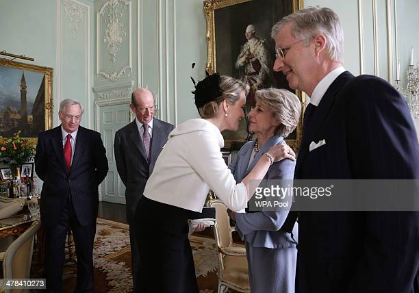 Queen Mathilde of Belgium is greeted by Birgitte Duchess of Gloucester as King Philippe of Belguim Prince Richard Duke of Gloucester and Prince...
