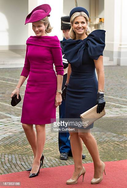 Queen Mathilde of Belgium is met by Queen Maxima of the Netherlands during an official visit by King Philippe and Queen Mathilde of Belgium to The...