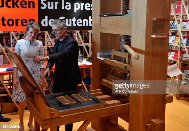 Queen Mathilde of Belgium is shown a socalled Gutenberg printing press as she visits the French pavillion at the Frankfurt Book Fair 2017 in...