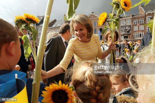 Queen Mathilde Of Belgium is welcomed by children of the city welcome with sunflowers after visiting the Eurofleurs 2017 Championship on September 15...