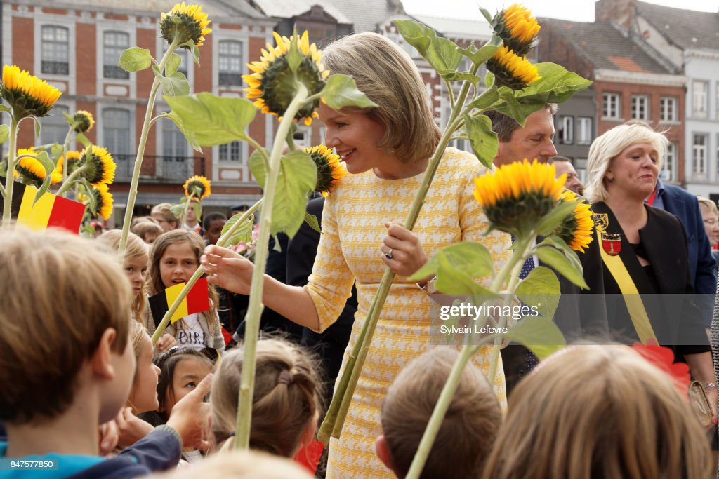 Queen Mathilde Of Belgium is welcomed by children of the