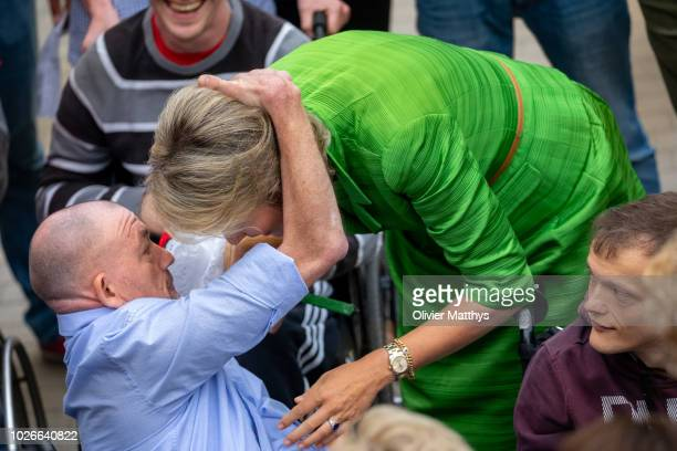 Queen Mathilde of Belgium is welcomed by disabled persons during a holiday camp at Ter Helme on September 4 2018 in Oostduinkerke Belgium