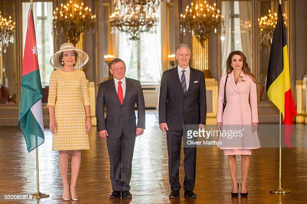 Queen Mathilde of Belgium King Abdullah II of Jordan King Philippe of Belgium and Queen Rania of Jordan pose for the official photo at the Royal...