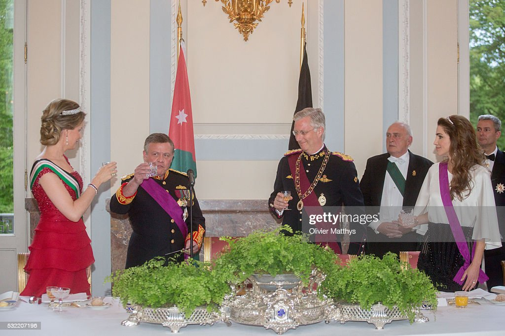 Queen Mathilde of Belgium, King Abdullah II of Jordan, King Philippe of Belgium and Queen Rania of Jordan drink a toast during the gala dinner at the Royal Palace of Lakaen on May 18, 2016 in Brussels, Belgium.
