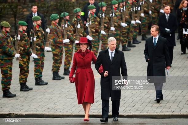 Queen Mathilde of Belgium King Philippe Filip of Belgium and Grand Duke Henri of Luxembourg leave the Mardasson Memorial after the commemoration of...