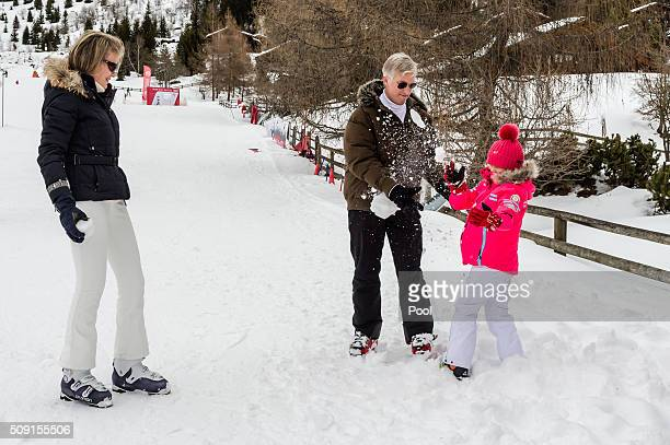 Queen Mathilde of Belgium King Philippe of Belgium and Princess Eléonore of Belgium pose take part in a snowball fight during their family skiing...