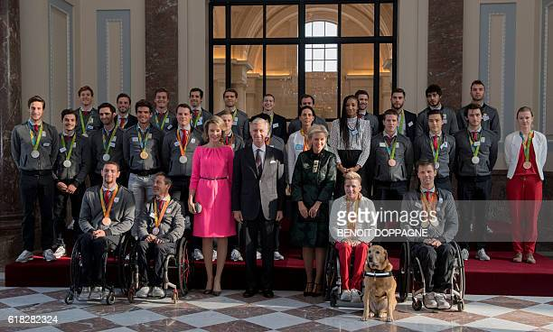 Queen Mathilde of Belgium King Philippe of Belgium Princess Astrid of Belgium and athletes who won medals during the Rio Olympic games and...
