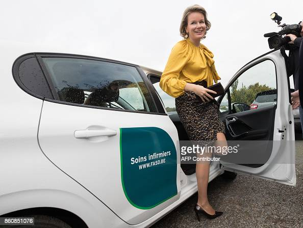 Queen Mathilde of Belgium leaves a nurse\'s car within a visit to the ...
