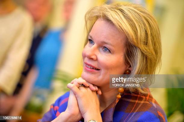 Queen Mathilde of Belgium looks on during a visit to the nursery Het Vlindertje for the week of reading aloud in Boutersem on November 16 2018 /...