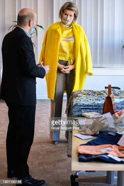 Queen Mathilde of Belgium meets with Dominique Michel who represents the fashion and clothing sector take part in a round table organized by Comeos,...
