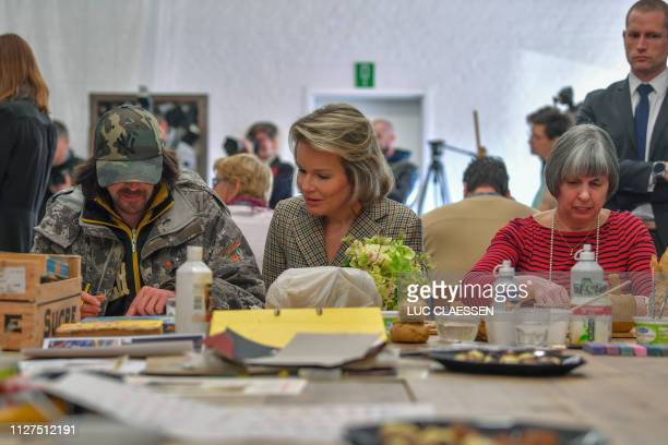 Queen Mathilde of Belgium pictured during a visit of Belgian Royal couple in Antwerp province with a social and artistic workshop called De Loods for...