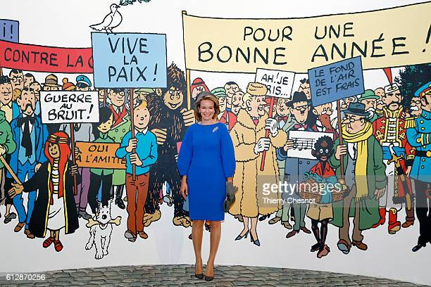 Queen Mathilde of Belgium poses for photos in front of a mural of comic characters from the comic book series Tintin on October 5 2016 in Paris...