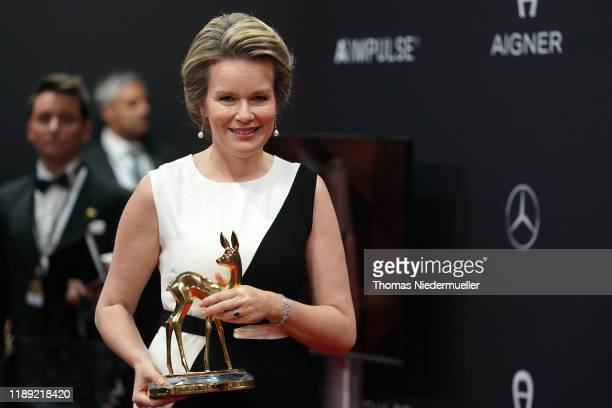Queen Mathilde of Belgium poses with award during the 71th Bambi Awards winners board at Festspielhaus Baden-Baden on November 21, 2019 in...