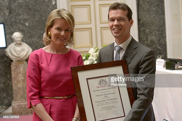 Queen Mathilde of Belgium poses with Professor Dirk Timmerman as she attends the InbevBaillet Latour ceremony on April 23 2014 in Brussels Belgium