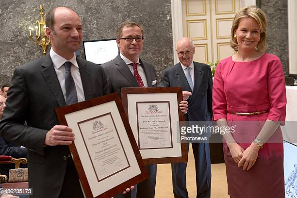 Queen Mathilde of Belgium poses with Professor Edouard Louis and Professor Denis as she attends the InbevBaillet Latour ceremony on April 23 2014 in...