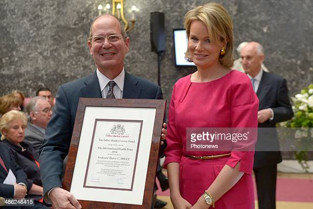 Queen Mathilde of Belgium poses with Professor Harry CDietz as she attends the InbevBaillet Latour ceremony on April 23 2014 in Brussels Belgium