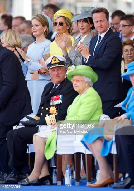 Queen Mathilde of Belgium Queen Maxima of The Netherlands Samantha Cameron and British Prime Minister David Cameron stand behind King Harald of...