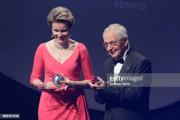 Queen Mathilde of Belgium receives the award from Klaus Toepfer during the German Sustainability Award at Maritim Hotel on December 8 2017 in...