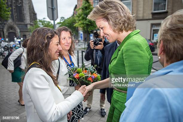 Queen Mathilde of Belgium shakes hand with Anderlecht Alderwoman Fatiha El Ikdimi during a ceremony for the Federal Poverty Reduction Prize on June...