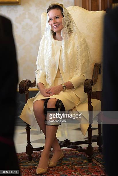 Queen Mathilde of Belgium smiles during a meeting with Pope Francis at his private library in the Apostolic Palace on March 9 2015 in Vatican City...