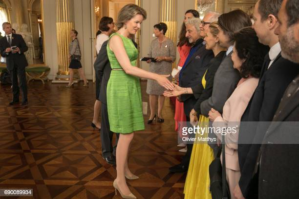 Queen Mathilde of Belgium speaks to guests during a lunch for Queen Elisabeth Competition on May 30 2017 in Brussels Belgium