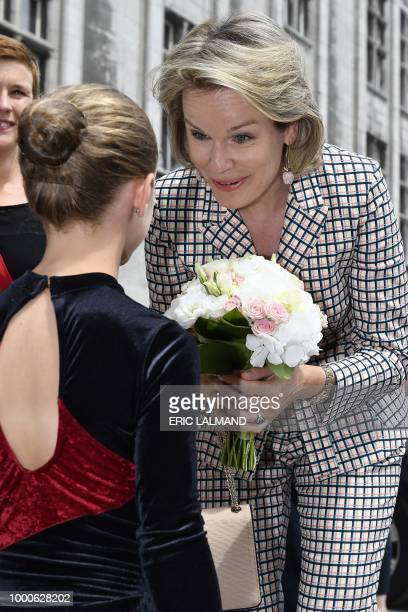 Queen Mathilde of Belgium speaks with a gymnast during a royal visit to the 'Eurogym 2018' biannual European Gymnastics festival for 12 to 18 year...