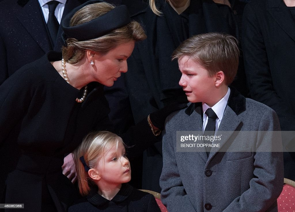 Queen Mathilde of Belgium speaks with Prince Gabriel (R) and Princess Eleonore as they attend the funeral ceremony of Queen Fabiola at the Saint Michael and Saint Gudula Cathedral in Brussels on December 12, 2014. Queen Fabiola de Mora y Aragon, widow of Belgian King Baudouin, passed away on December 5 at the age of 86.