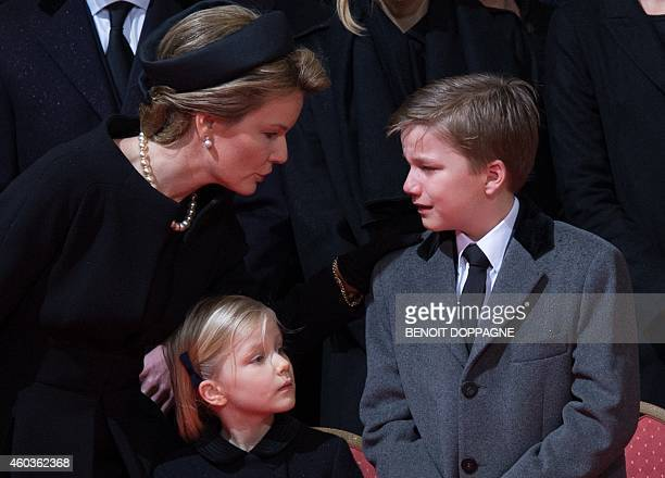 Queen Mathilde of Belgium speaks with Prince Gabriel and Princess Eleonore as they attend the funeral ceremony of Queen Fabiola at the Saint Michael...