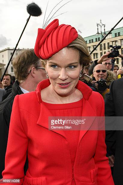 Queen Mathilde of Belgium stands in front of the Brandenburg Gate on February 17 2014 in Berlin Germany