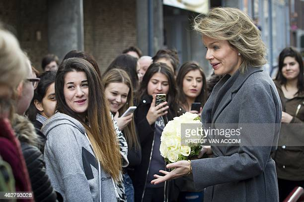 Queen Mathilde of Belgium talks to students as she arrives for a visit at the CAW Limburg in Genk and at the center De Sfeer on February 4 2015 AFP...
