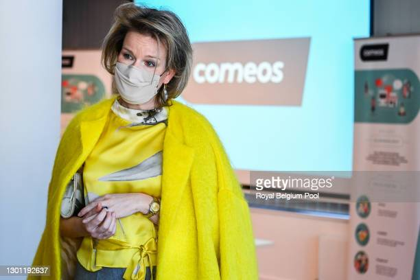 Queen Mathilde of Belgium together with representatives of the fashion and clothing sector take part in a round table organized by Comeos, the...