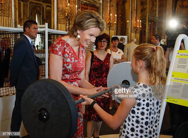 Queen Mathilde of Belgium visits the exhibition on science and culture 'Science et culture au Palais', at the Royal Palace in Brussels, on July 20,...