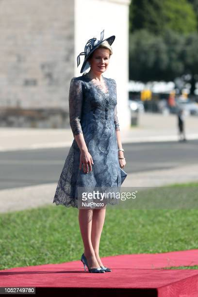 Queen Mathilde of Belgium waits as Portugal's President Marcelo Rebelo de Sousa and King Philippe of Belgium review the guards during a welcome...